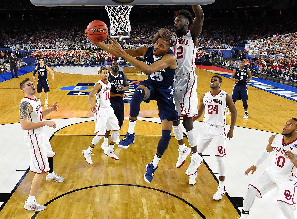 Mikal Bridges of Villanova drives to the basket against Khadeem Lattin of Oklahoma.