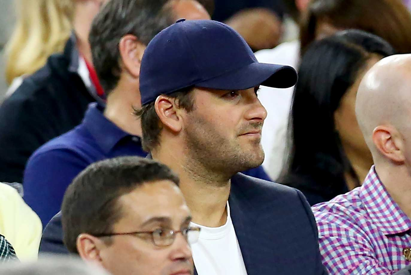 Dallas quarterback Tony Romo looks on during the NCAA Men's Final Four semifinal in Houston between Villanova and Oklahoma.