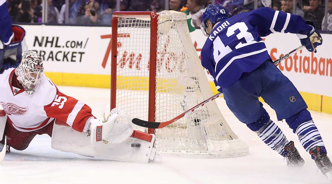 Jimmy Howard makes a stop on Nazem Kadri as the Toronto Maple Leafs lose 3-2 to the Detroit Red Wings.