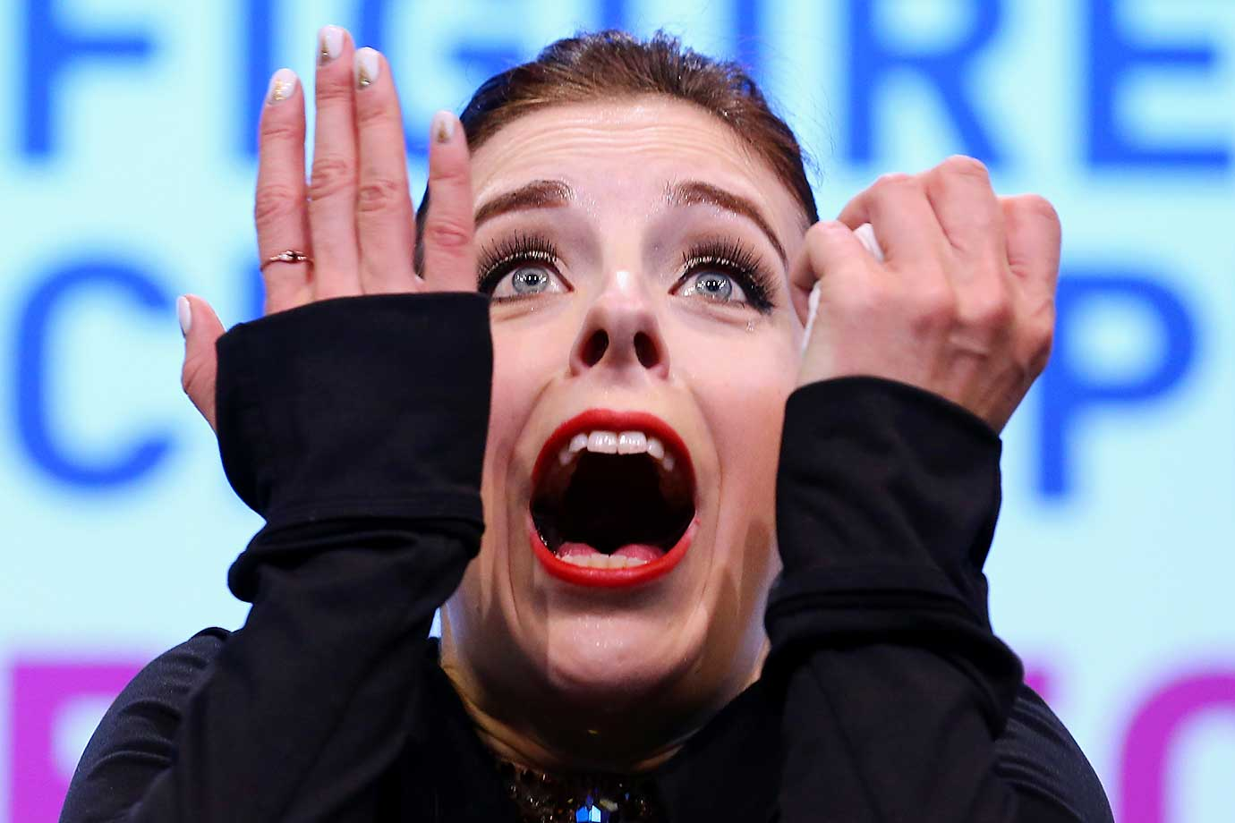 Ashley Wagner of the U.S. reacts after hearing her score in the Ladies Free Skate program at the world championships. She would go on to finish second, behind Evgenia Medvedeva of Russia.