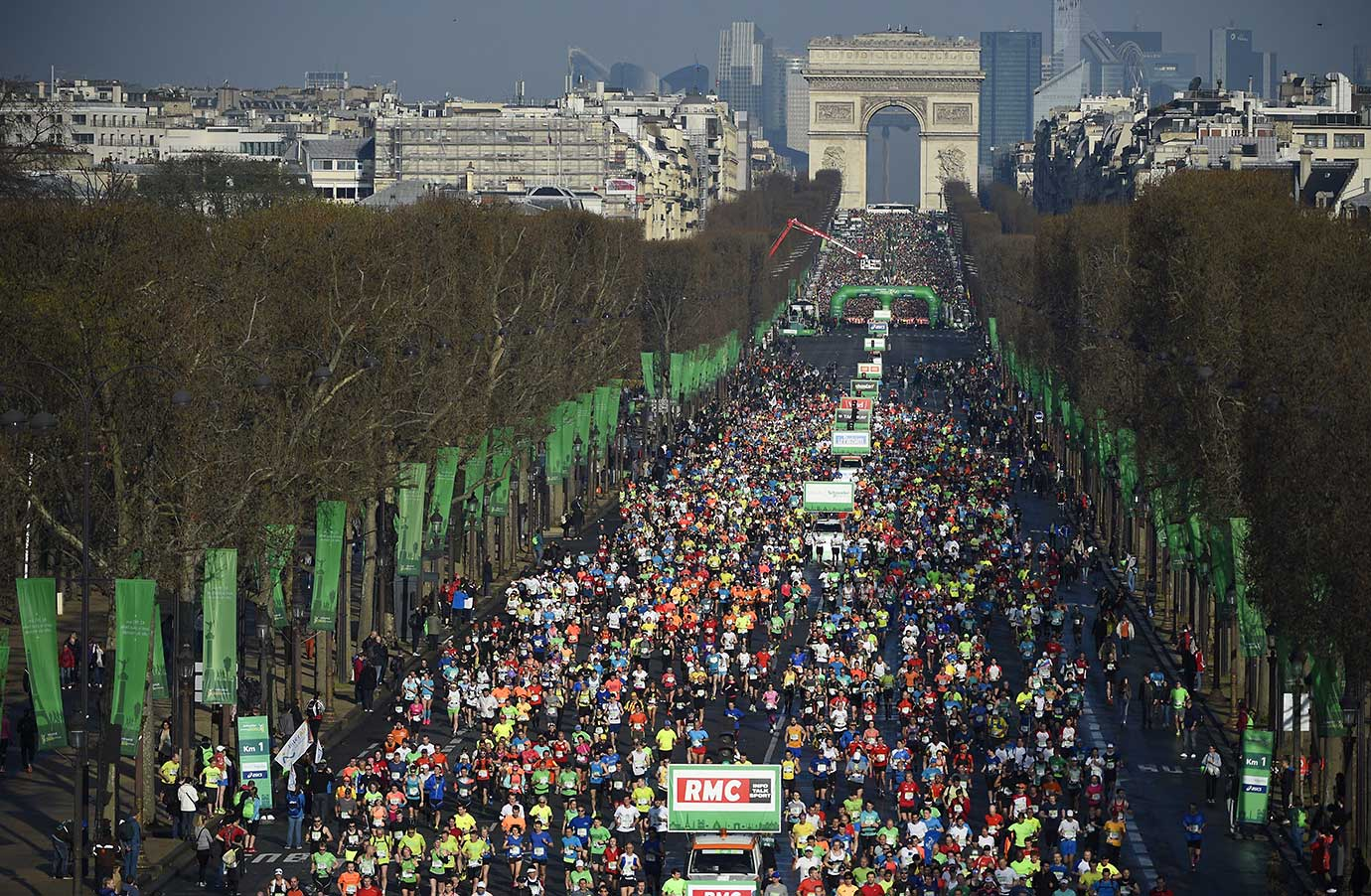 Some 57,000 participants from 160 countries take the start of the 40th Paris Marathon near the Arc de Triomphe monument.
