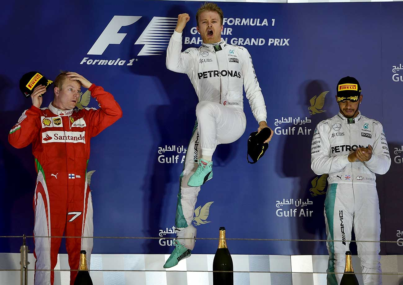 Nico Rosberg celebrates on the podium after winning the Bahrain Formula One Grand Prix next to second-place driver Kimi Raikkonen (left) and third-place finisher Lewis Hamilton.