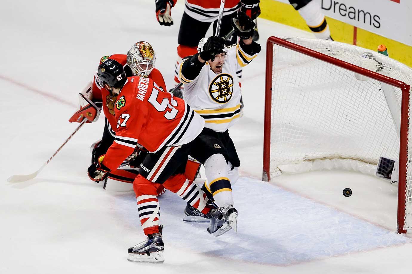 Brad Marchand of the Boston Bruins scores on goalie Scott Darling of the Chicago Blackhawks.