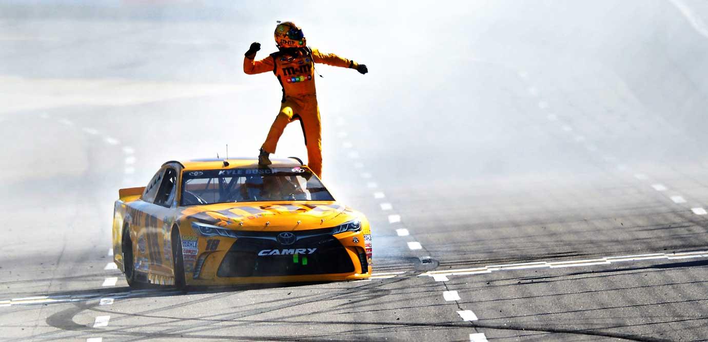 Kyle Busch celebrates after winning the NASCAR Sprint Cup Series STP 500 in Martinsville, Va.