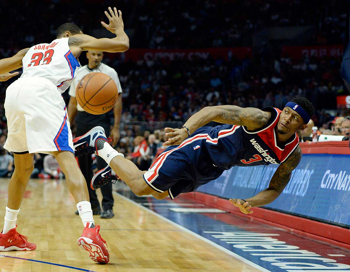 Bradley Beal of the Washington Wizards makes the ball go out of bounds against Wesley Johnson of the Los Angeles Clippers.