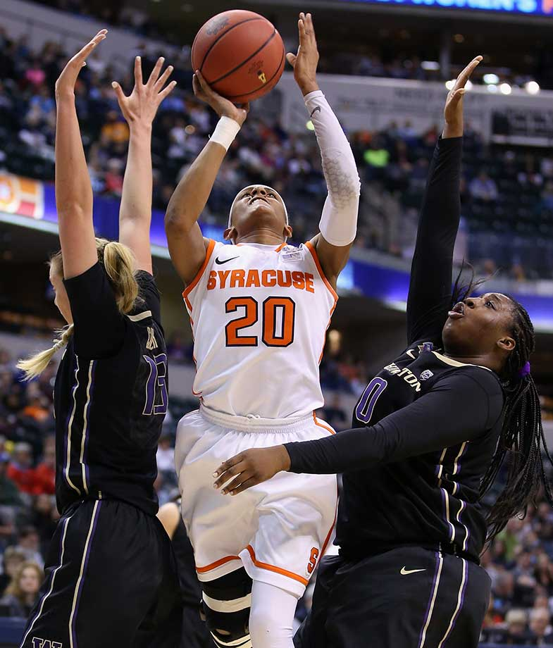 Brittney Sykes of Syracuse shoots against Katie Collier (13) and Chantel Osahor of the Washington Huskies.