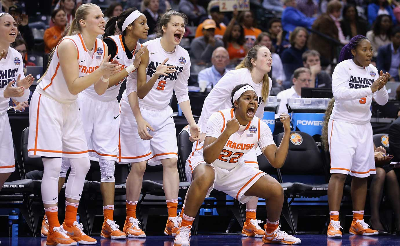 Taylor Ford cheers on her Syracuse teammates in an 80-59 win over the Washington Huskies in a national semifinal.
