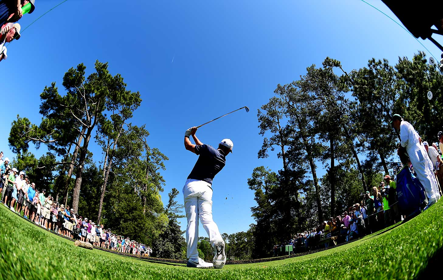 Rory McIlroy plays his shot from the sixth tee during a practice round prior to the start of the Masters.