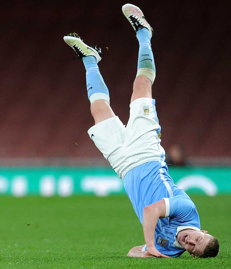 Jacob Davenport of Manchester City hits the turf during the match between Arsenal U18 and Manchester City U18 at Emirates Stadium in London.