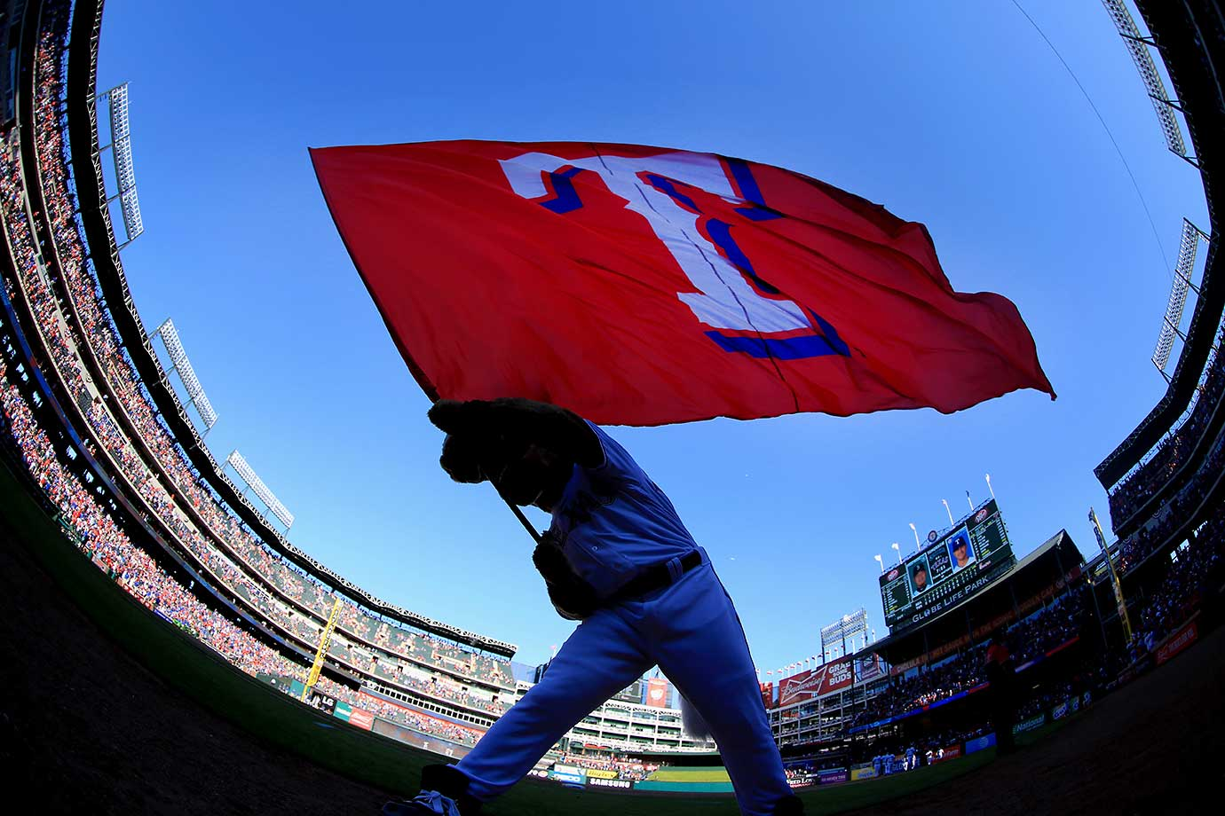 Captain, the Texas Rangers mascot, waves the team flag after the team beat the Seattle Mariners 3-2.