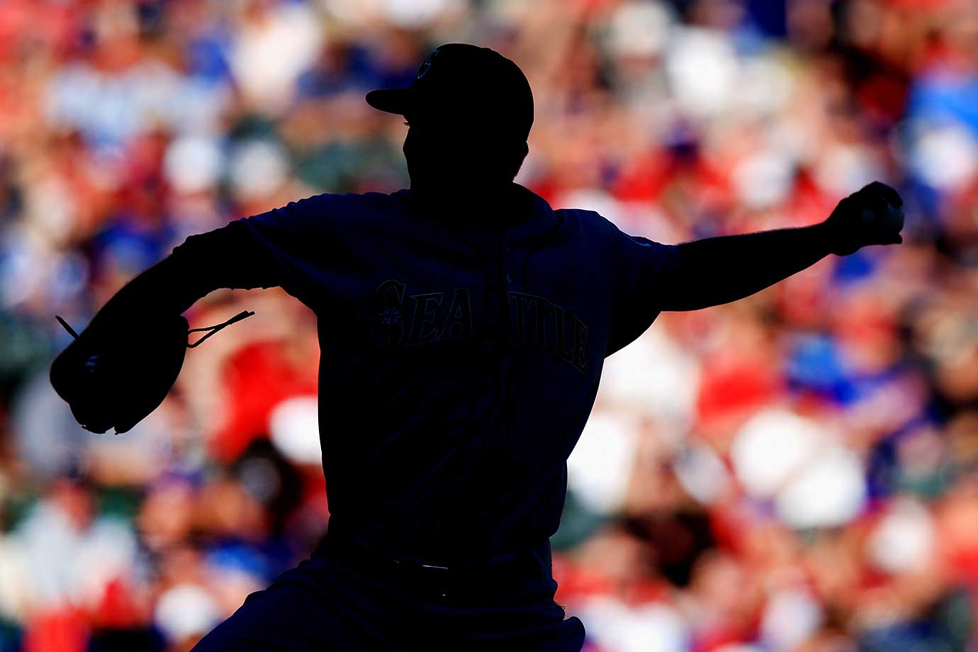 Mike Montgomery of the Seattle Mariners pitches against the Texas Rangers on Opening Day in Arlington.