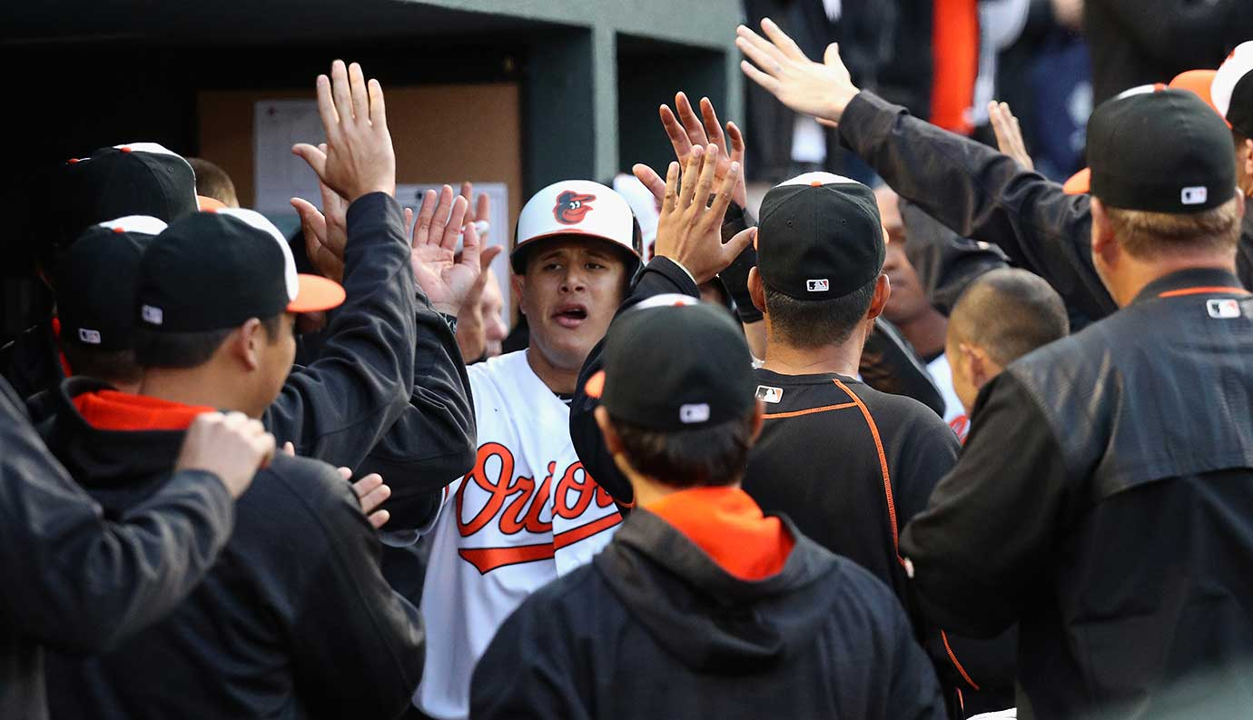 Here are some of the images that caught our eye on a Monday full of baseball, starting with Manny Machado being congratulated by his Baltimore teammates after scoring in the fifth inning against the Minnesota Twins.