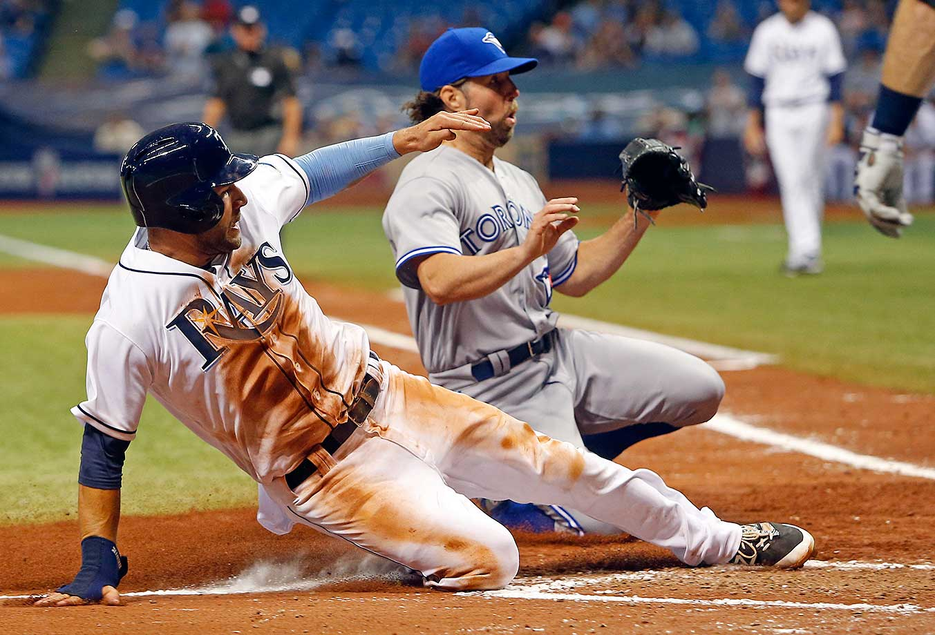 Kevin Kiermaier of Tampa Bay slides home ahead of pitcher R.A. Dickey of the Toronto Blue Jays.