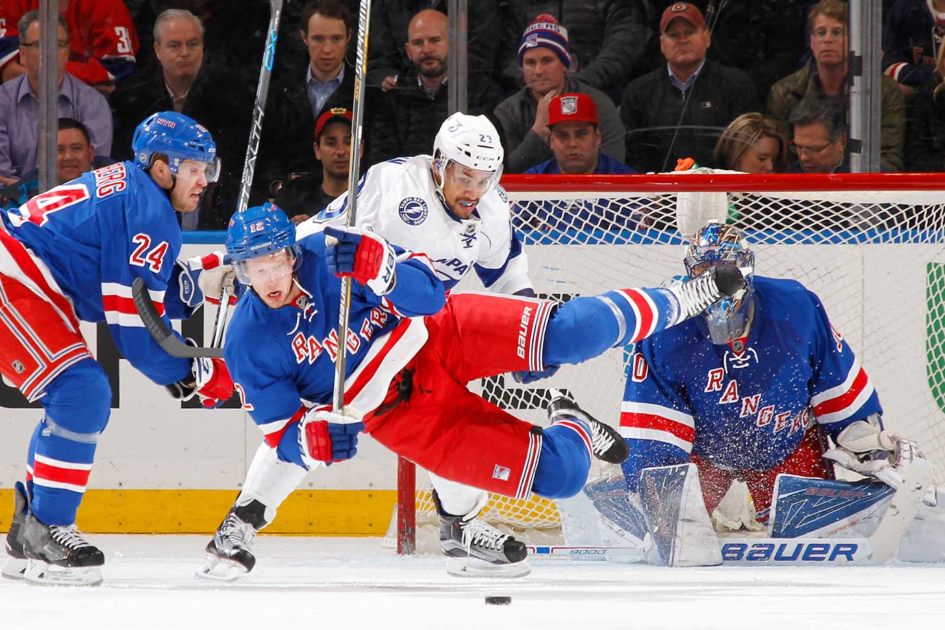 Eric Staal of the New York Rangers gets airborne after being tripped by J.T. Brown of the Tampa Bay Lightning.