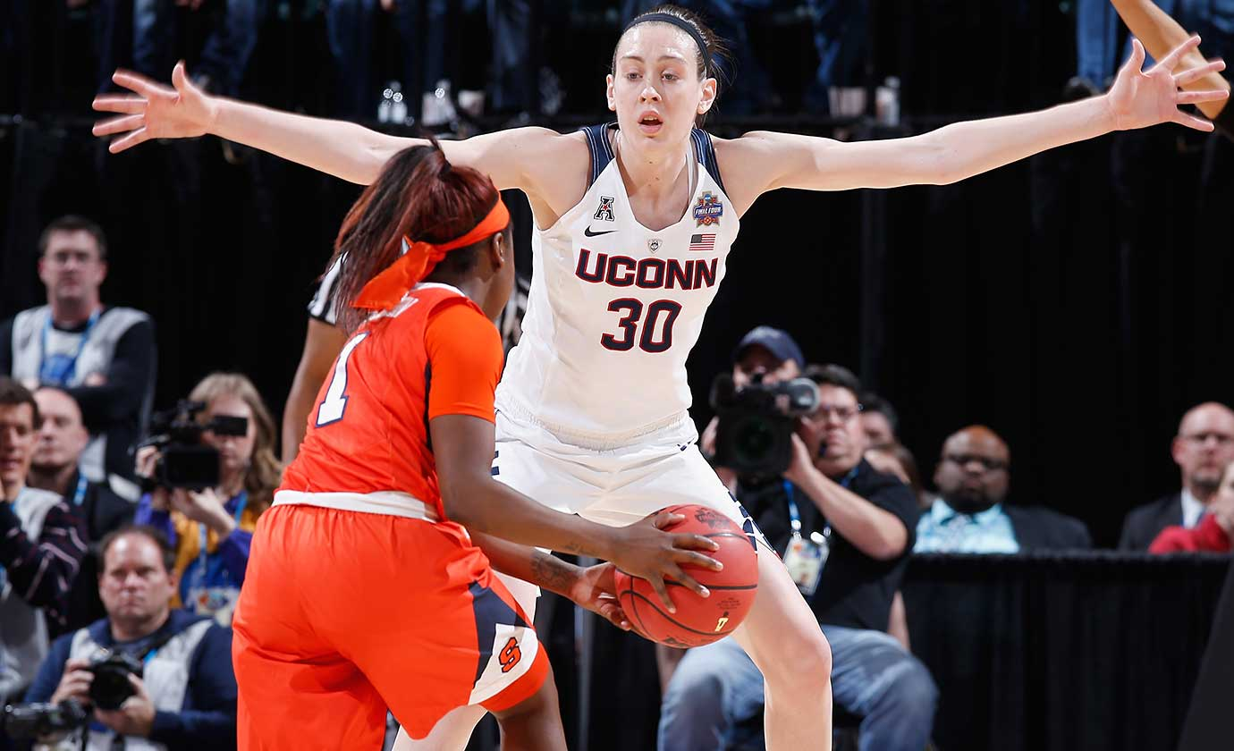 Breanna Stewart defends against Alexis Peterson of Syracuse as UConn won its 75th consecutive game and the 11th national title in school history.