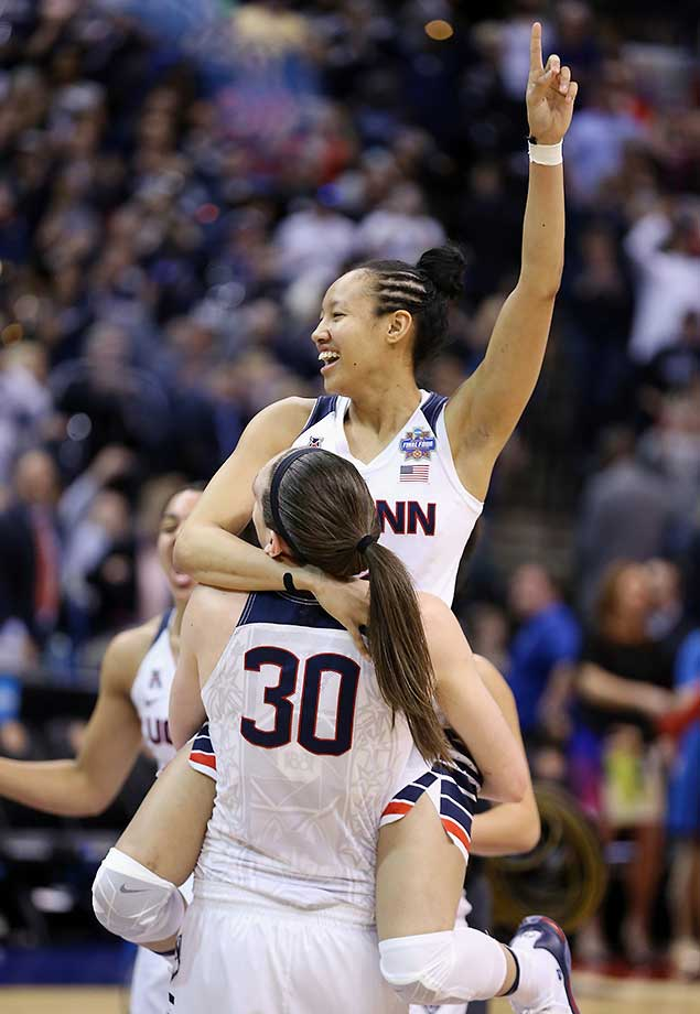 Saniya Chong (12) and Breanna Stewart celebrate UConn's  82-51 victory over Syracuse in the women's championship game in Indianapolis. UConn's seniors went 151-5 in their careers there.