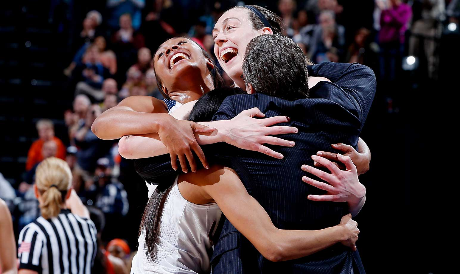 Here are some of the images that caught our eye on a night when the Connecticut women won a record fourth consecutive national championship in basketball. Pictured here, Breanna Stewart (30), Morgan Tuck (3), Moriah Jefferson (4) and coach Geno Auriemma embrace as the seniors took the bench in the 82-51 victory over Syracuse.