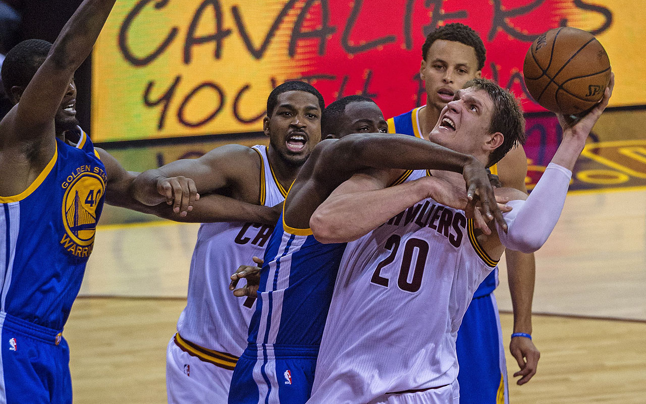 Draymond Green, pictured here holding down Timofey Mozgov, enjoyed a triple double in Game 6 -- 16 points, 11 rebounds and 10 assists.