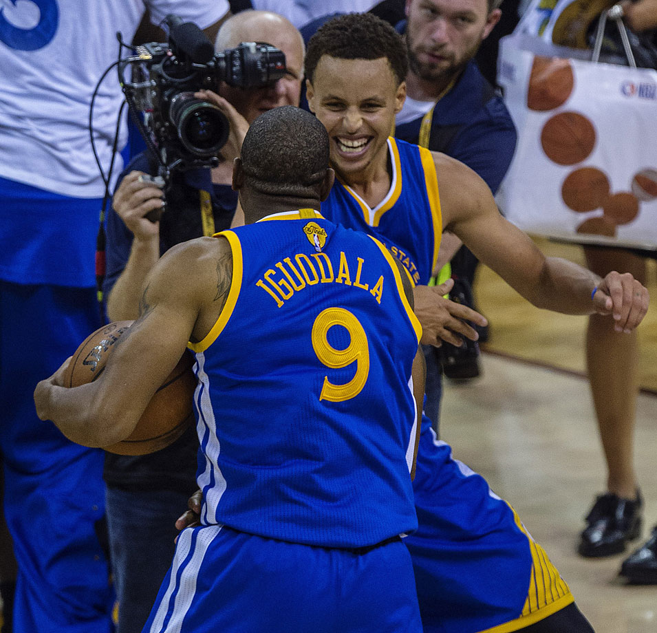 Andre Iguodala was named Finals MVP and celebrates here with regular season MVP Steph Curry.
