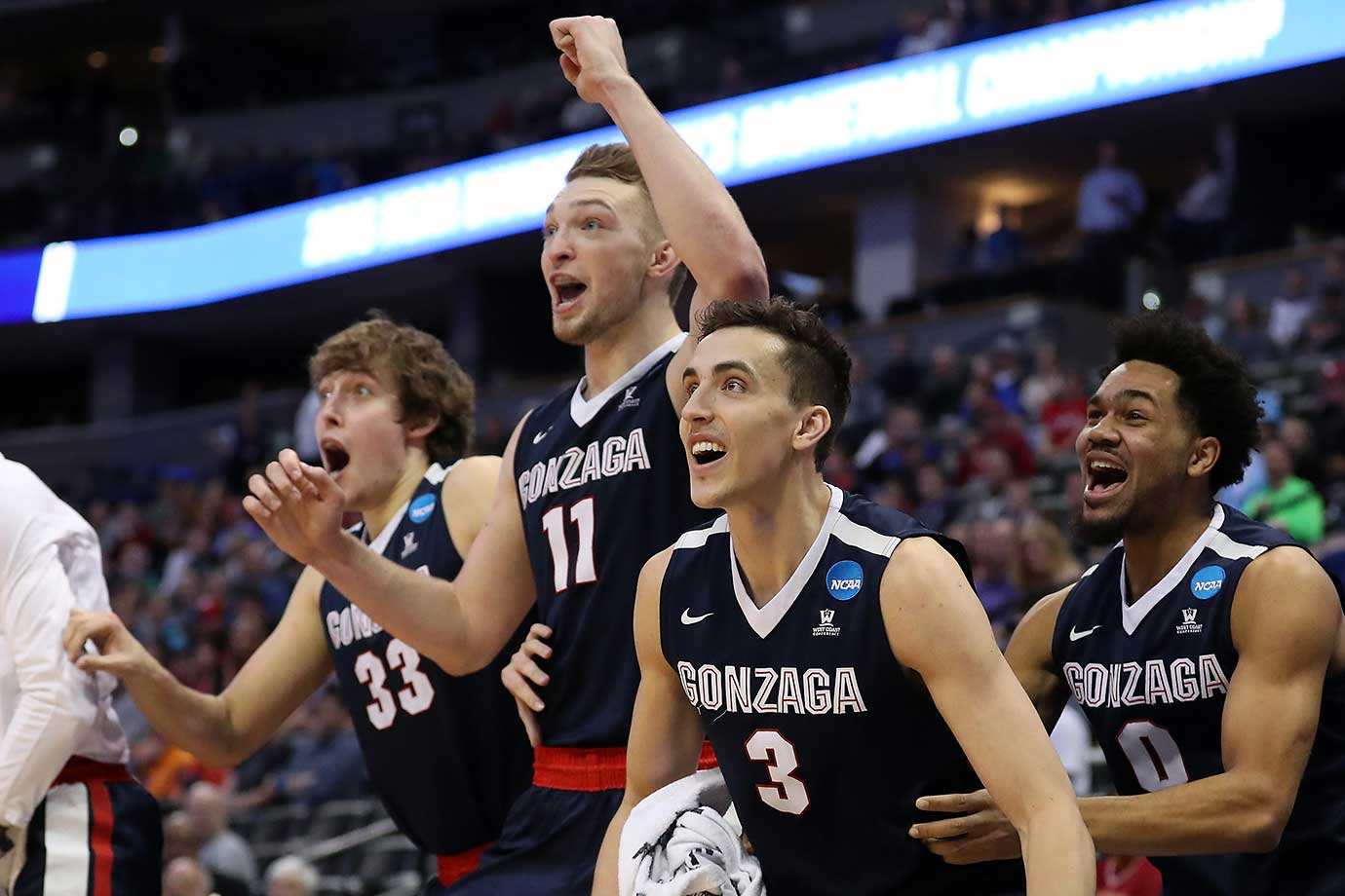 Kyle Wiltjer (33), Domantas Sabonis, Kyle Dranginis and Silas Melson of the Gonzaga Bulldogs celebrate an 82-59 win over No. 3 seed Utah.