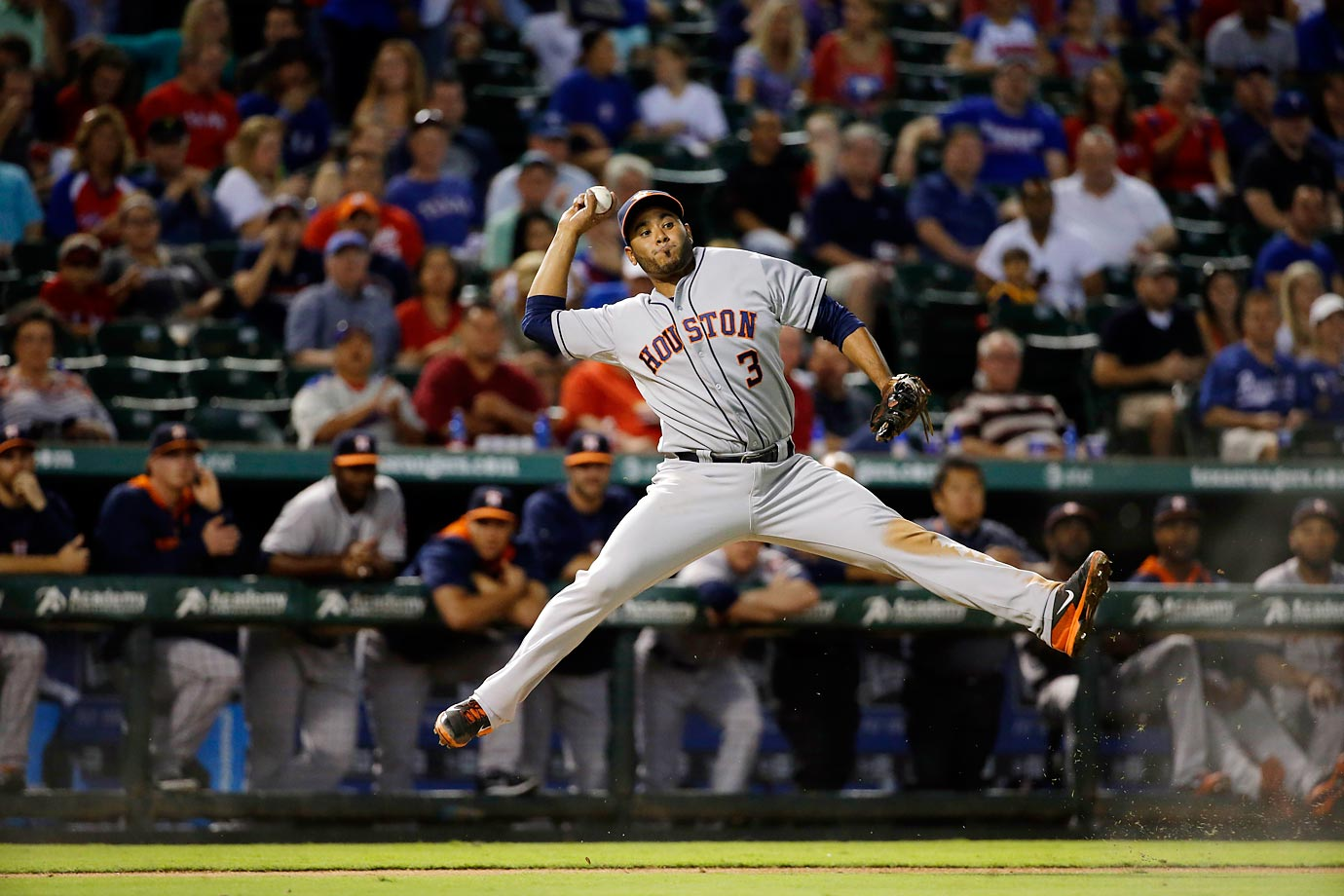 Houston Astros third baseman Gregorio Petit throws to first in a game against the Texas Rangers. The Rangers won 5-1.