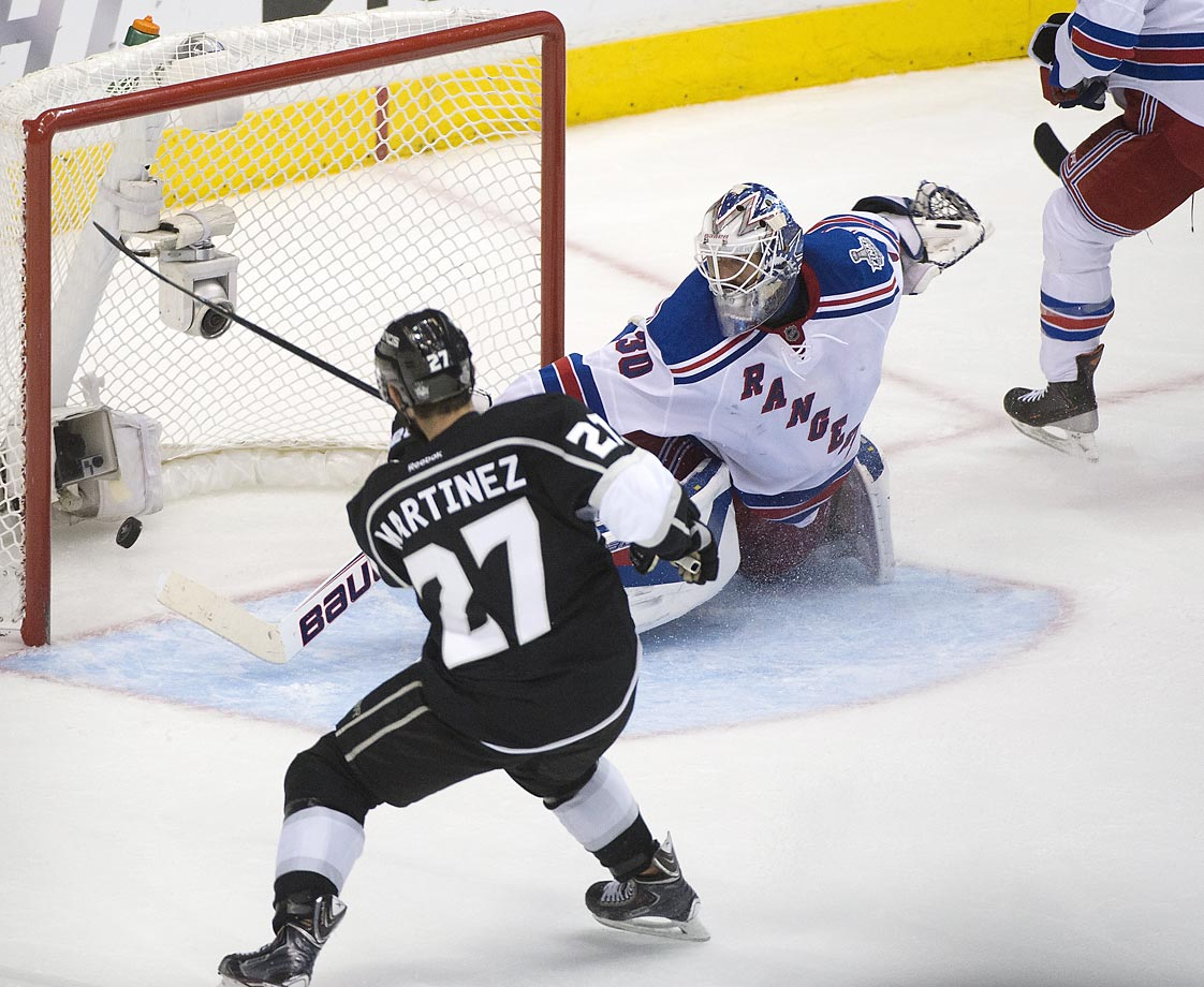 Alec Martinez of the Los Angeles Kings scores the Stanley Cup-winning goal in double overtime, beating New York Rangers goaltender Henrik Lundqvist. After being down 3-1 in its first-round series, Los Angeles completed its second title run in three years with the victory.