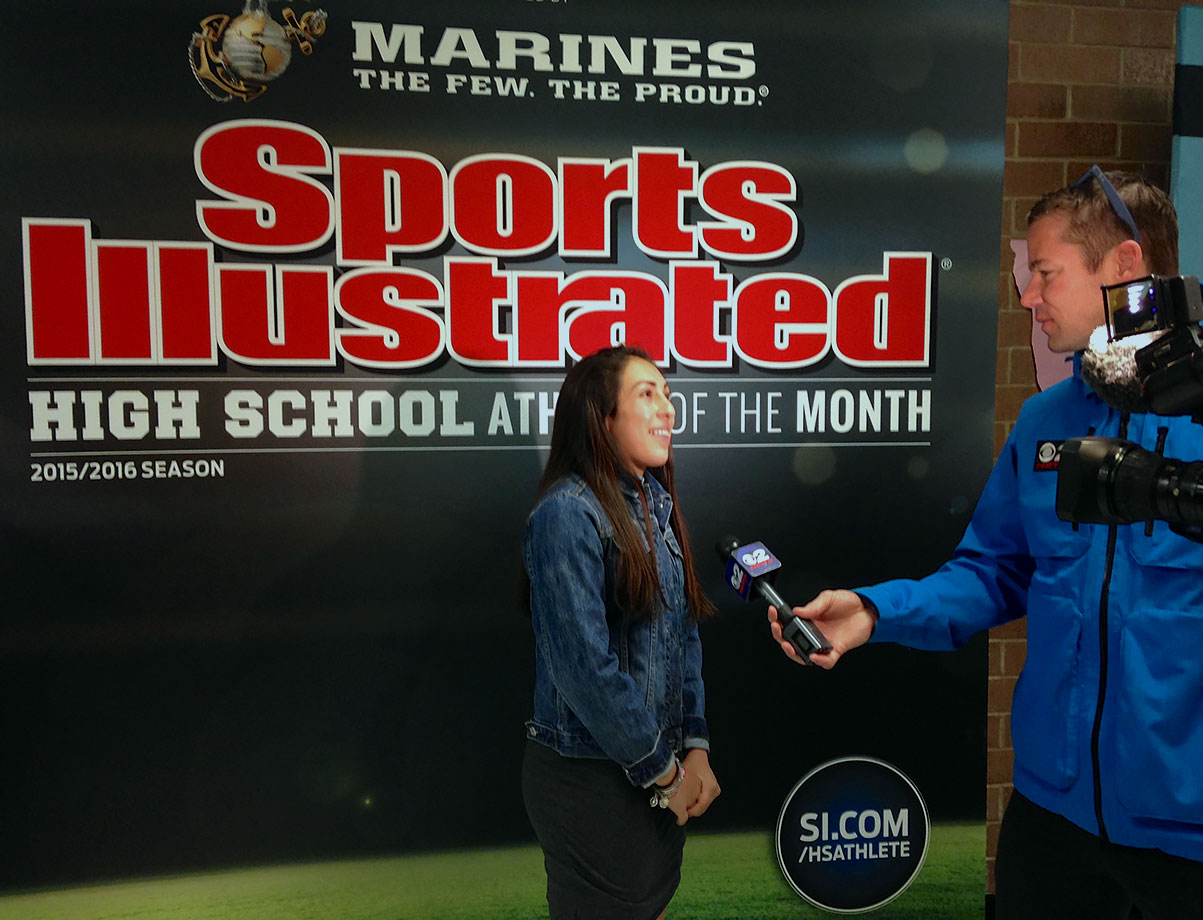 Sophia is interviewed by a local television news crew about her selection as SI's High School Athlete of the Month for February.