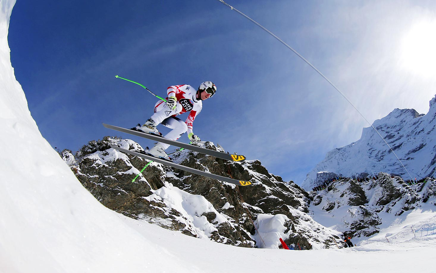 Austria's Hannes Reichelt is airborne on his way to win a World Cup downhill, in Wengen, Switzerland.