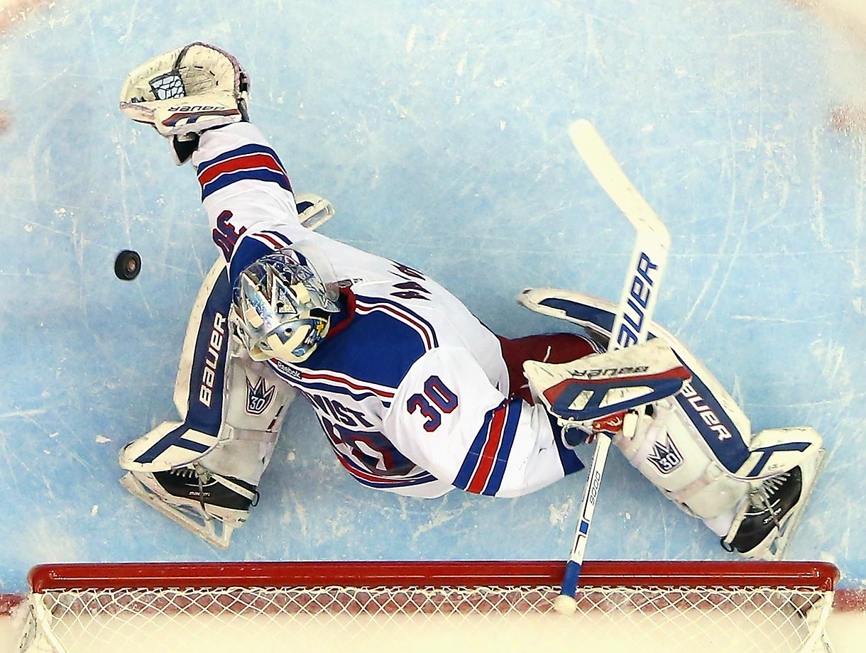 Henrik Lundqvist of the Rangers couldn't snatch this puck in a game against the Islanders.