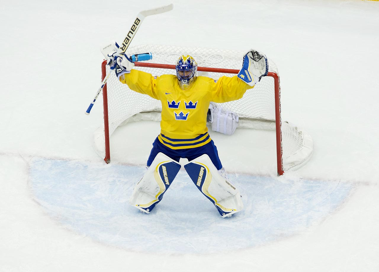 Henrik Lundqvist celebrates the win against Finland. He led the Swedes to gold eight years ago, when they beat Finland in the finals of the Turin Games.