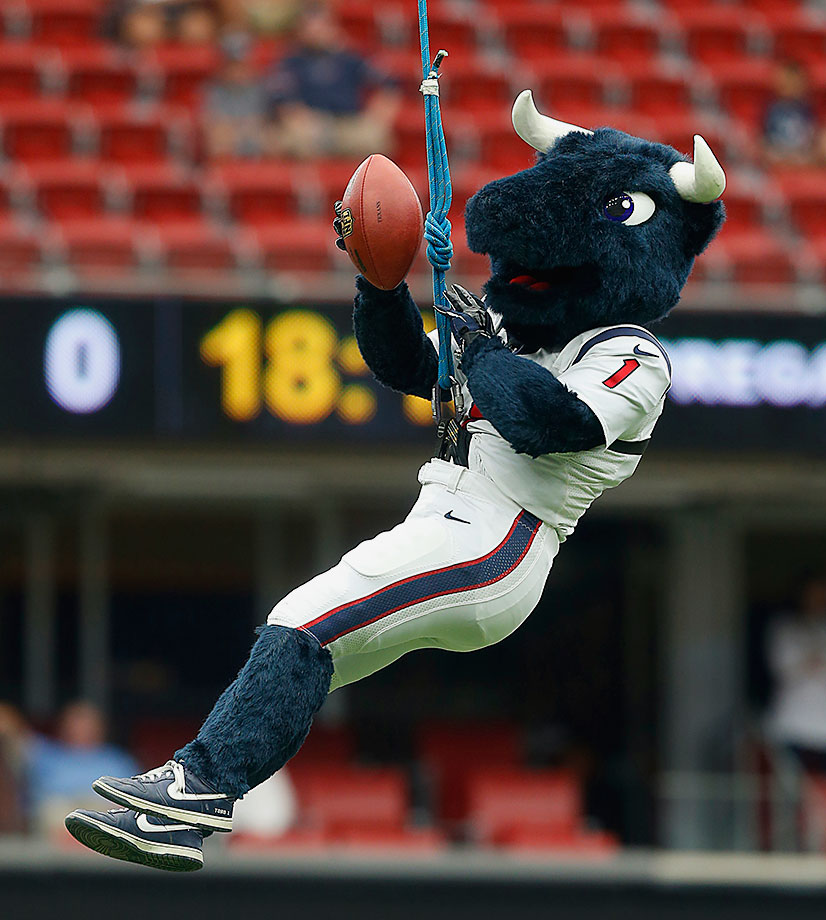 This big fella is awfully happy for an animal that rodeo Texans are always climbing on top of, kicking with spurs and freaking out with redneck clowns … How is a redneck clown NOT the Texans' mascot!?!