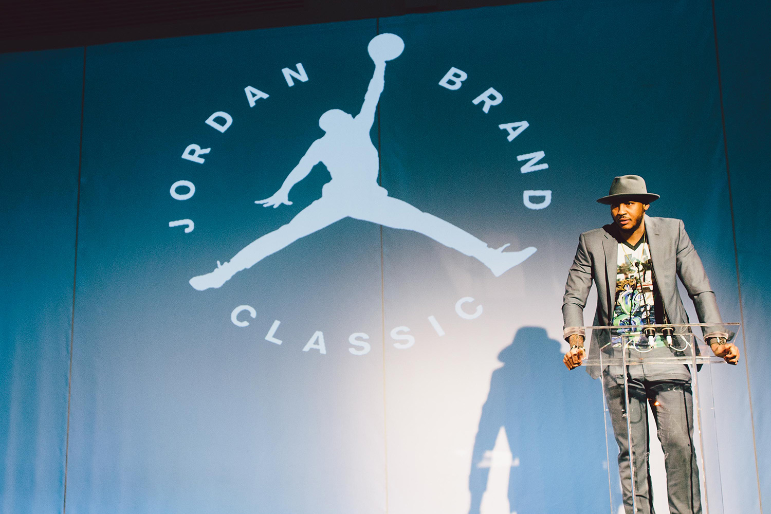 Carmelo Anthony giving a speech at the podium at the Jordan Brand Classic.