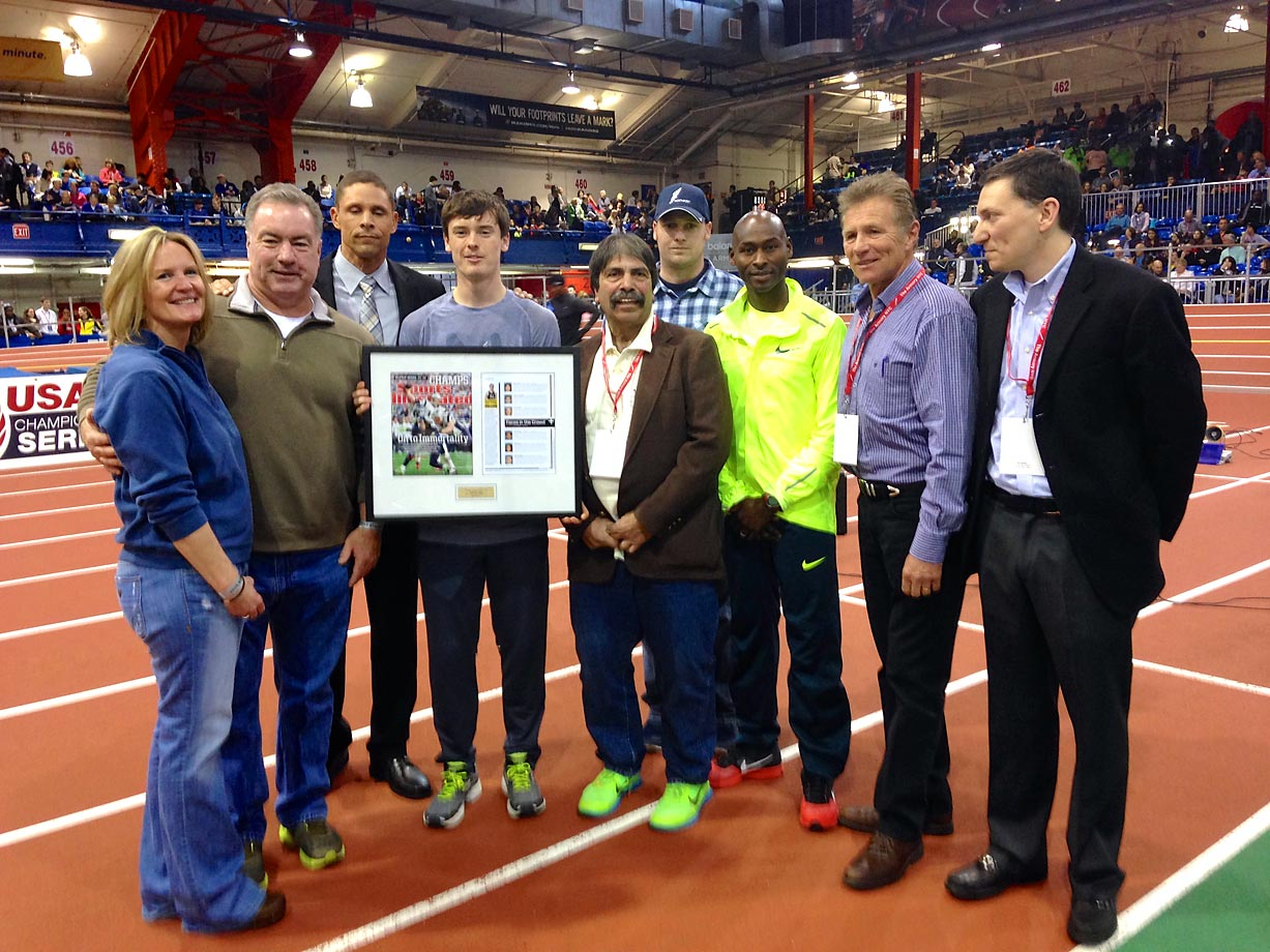 "Mikey's parents, coaches and a trio of world class athletes were on hand to congratulate the Northport High senior and defending national outdoor two-mile champion as he was handed a framed copy of the SI issue in which he was featured. From left to right: Parents Edie and Kevin Brannigan, NBC commentator and Olympic decathlete, Dan O'Brien, Mikey Brannigan, Rolling Thunder coach and founder Steve Cuomo, Northport High coach Jason Strom, Olympic medalist, five-time world champ and American record holder in seven middle-distance events, Bernard Lagat, former world champ, Eamonn Coghlan, known as the ""Chairman of the Boards"" for his indoor track success, and SI/SI.com executive editor B.J. Schecter."