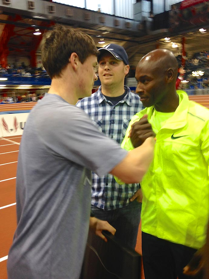 Bernard Lagat congratulates Mikey Brannigan as Mikey's high school coach looks on.