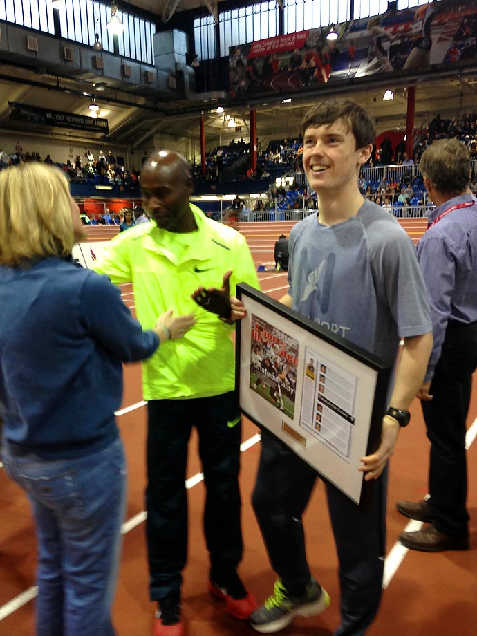 Mikey, holding his framed issue, would go on to turn in a 4:12.69 in the boys' high school invitational New Balance Mile later that evening, a personal best and good for third place.
