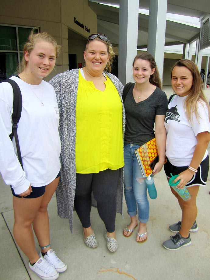 2012 Olympic weightlifter Holley Mangold chats with members of the Timber Creek High girls' weightlifting team.