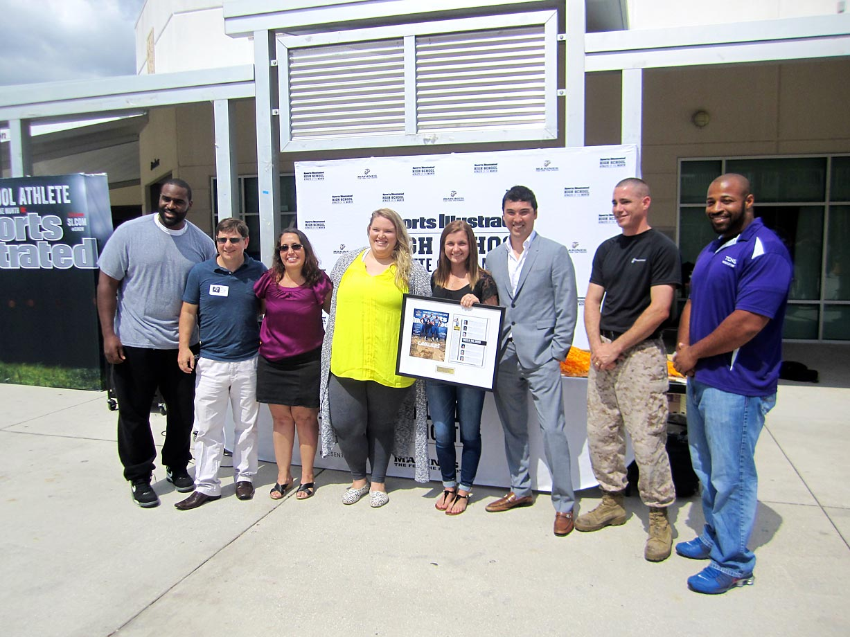From left to right: Lemuel Jeanpierre, parents Cade and Mary Braud, Olympic weightlifter Holley Mangold, SI High School Athlete of the Month Savannah Braud, Staff Sgt. Joe Andrew, and Timber Creek High girls' weightlifting coach Tyrone Harvey Jr. smile for the cameras.