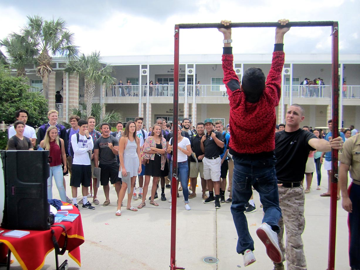 Timber Creek High students reached for the bar – and the sky – at the Marines' pull-up challenge.