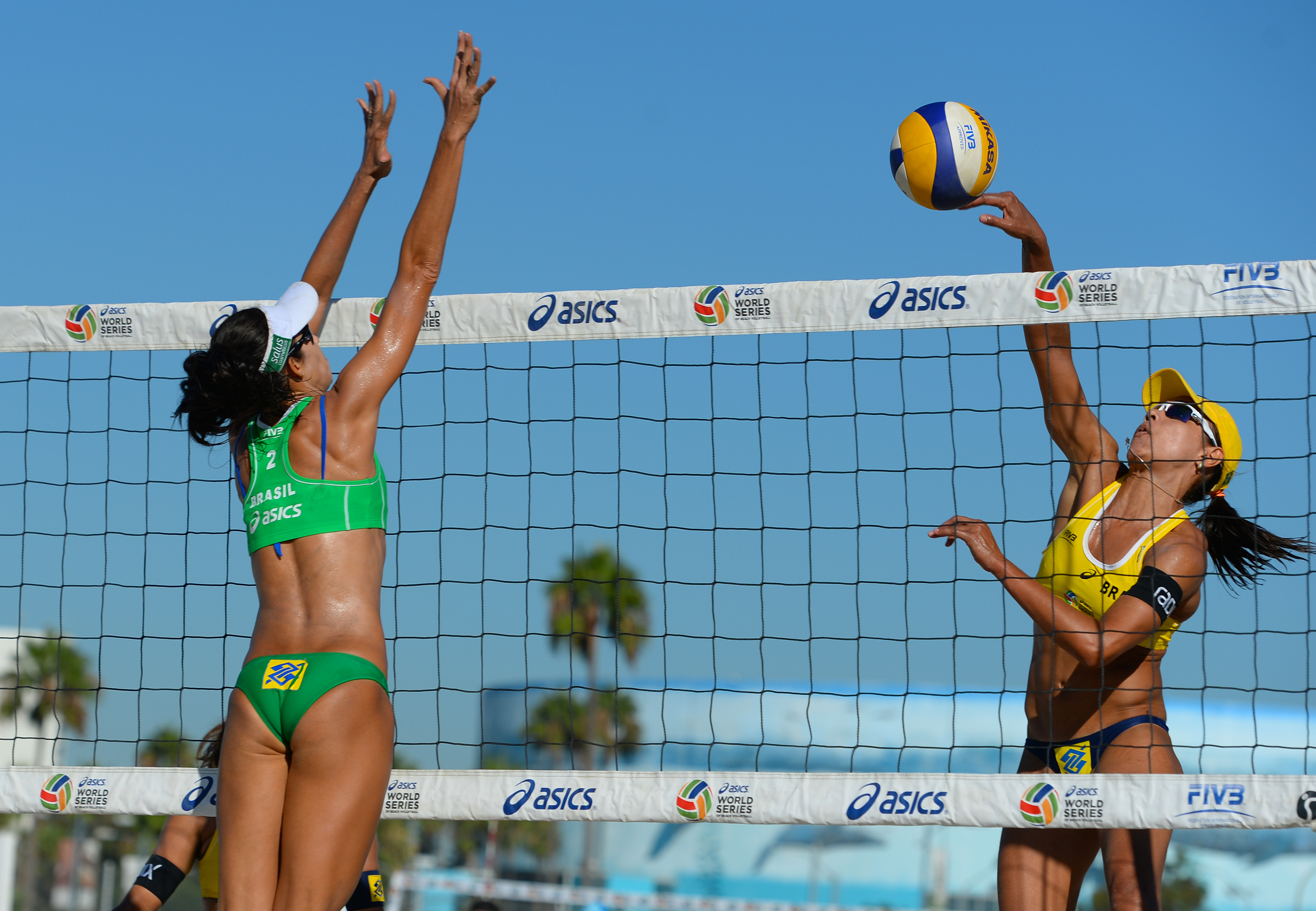 In an all-Brazilian first round pool play match, Juliana Feslisberta goes up high to attempt to kill the Mikasa. Talia Atunes and Larissa Franca defeated Felisberta and Maria Antonelli in two sets.