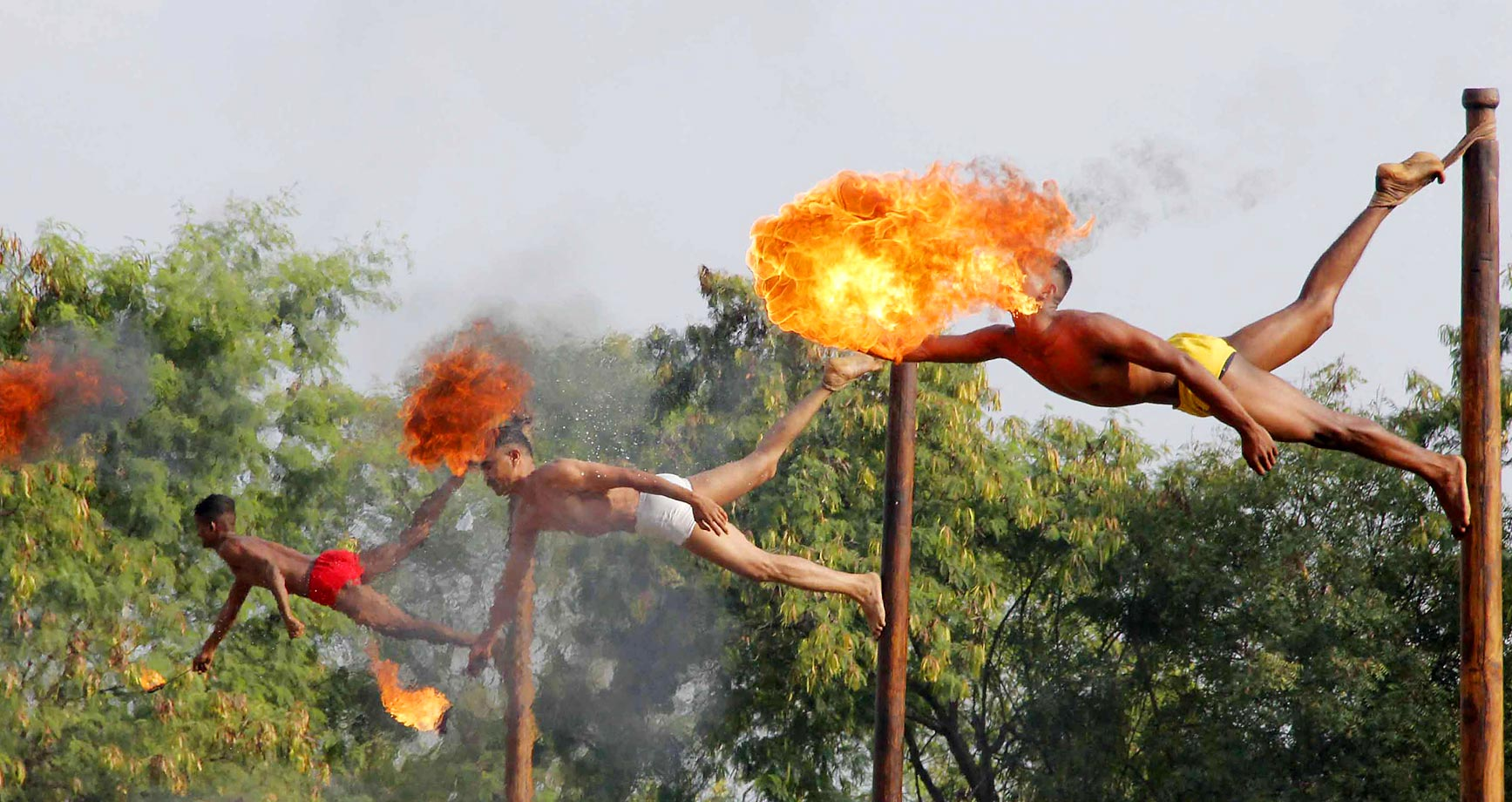 Indian soldiers take part in a demonstration of 'fire breathing' at the start of Operation Hand in Hand.