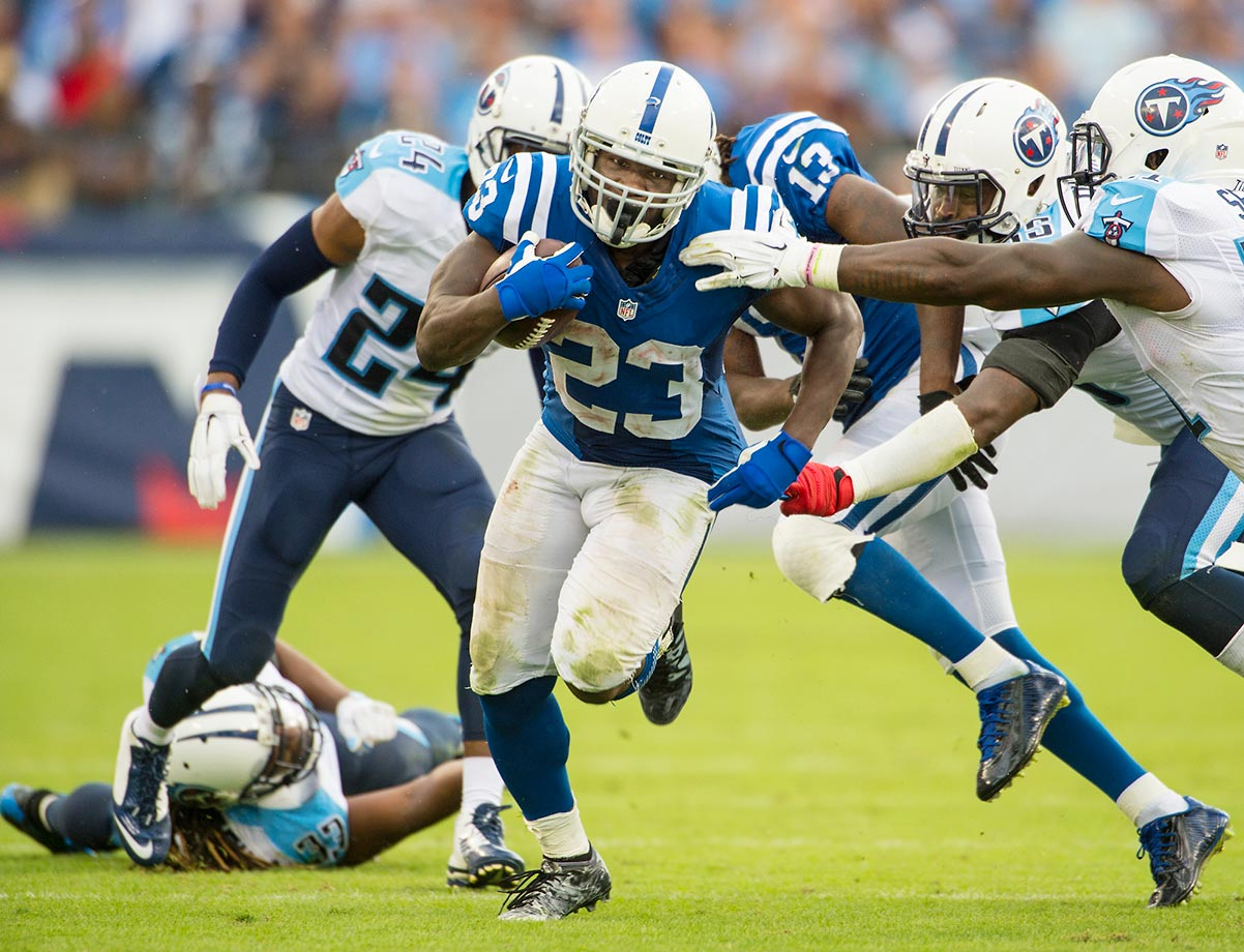 Indy running back Frank Gore tries to outrun the Tennessee Titans.