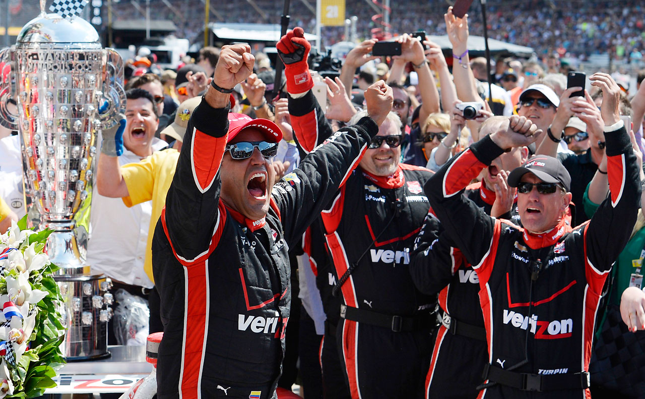Juan Pablo Montoya of Colombia celebrates with his teammates after winning the 99th running of the Indianapolis.