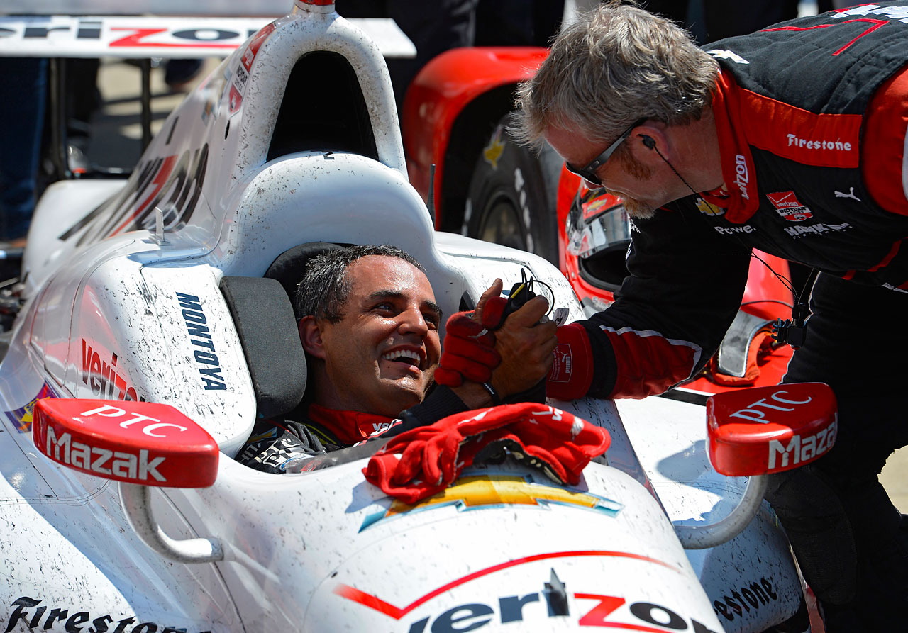 Juan Pablo Montoya celebrates with a teammate after winning.
