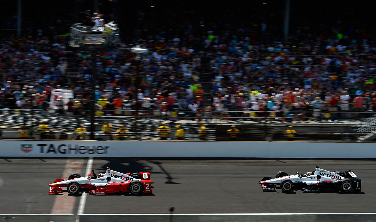 Juan Pablo Montoya crosses the finish line ahead of Will Power.