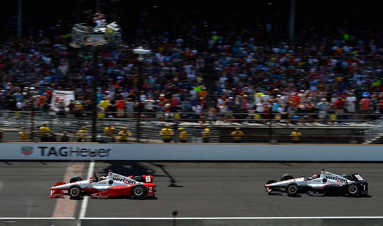 Juan Pablo Montoya crosses the finish line ahead of Will Power.