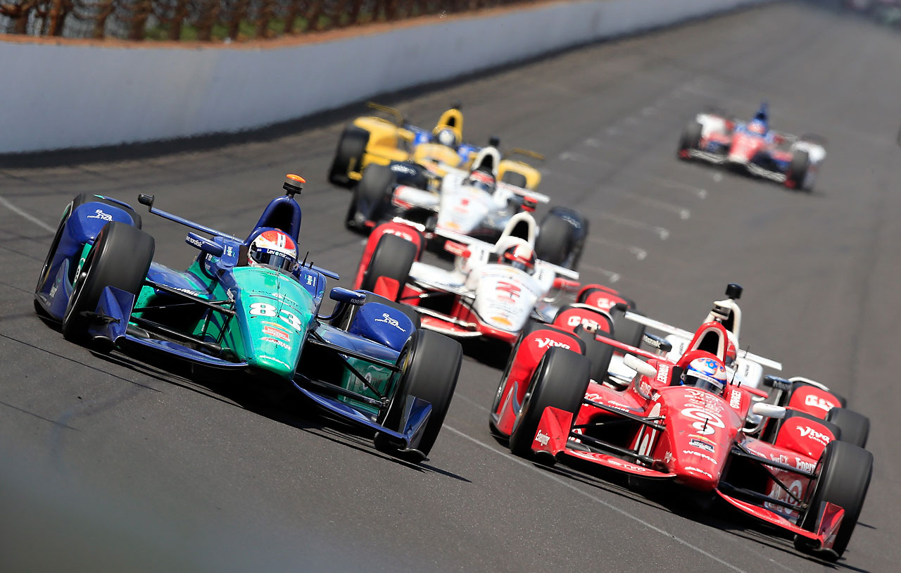 Charlie Kimball races ahead of a pack of cars during the 99th running of the Indianapolis 500.
