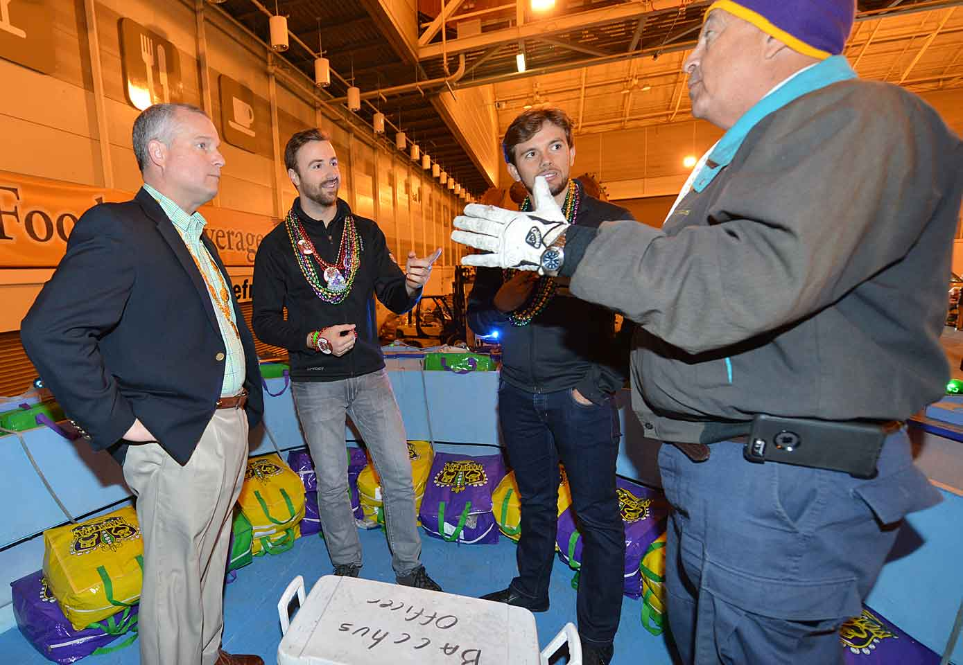 "The Art of the Throw: Learning proper bead toss technique from the pros, Clark Brennan the Captain of the Krewe of Bacchus, and Director of Security Greg Frederico. ""Don't want to look like a newbie out there,"" Hinchcliffe wrote."