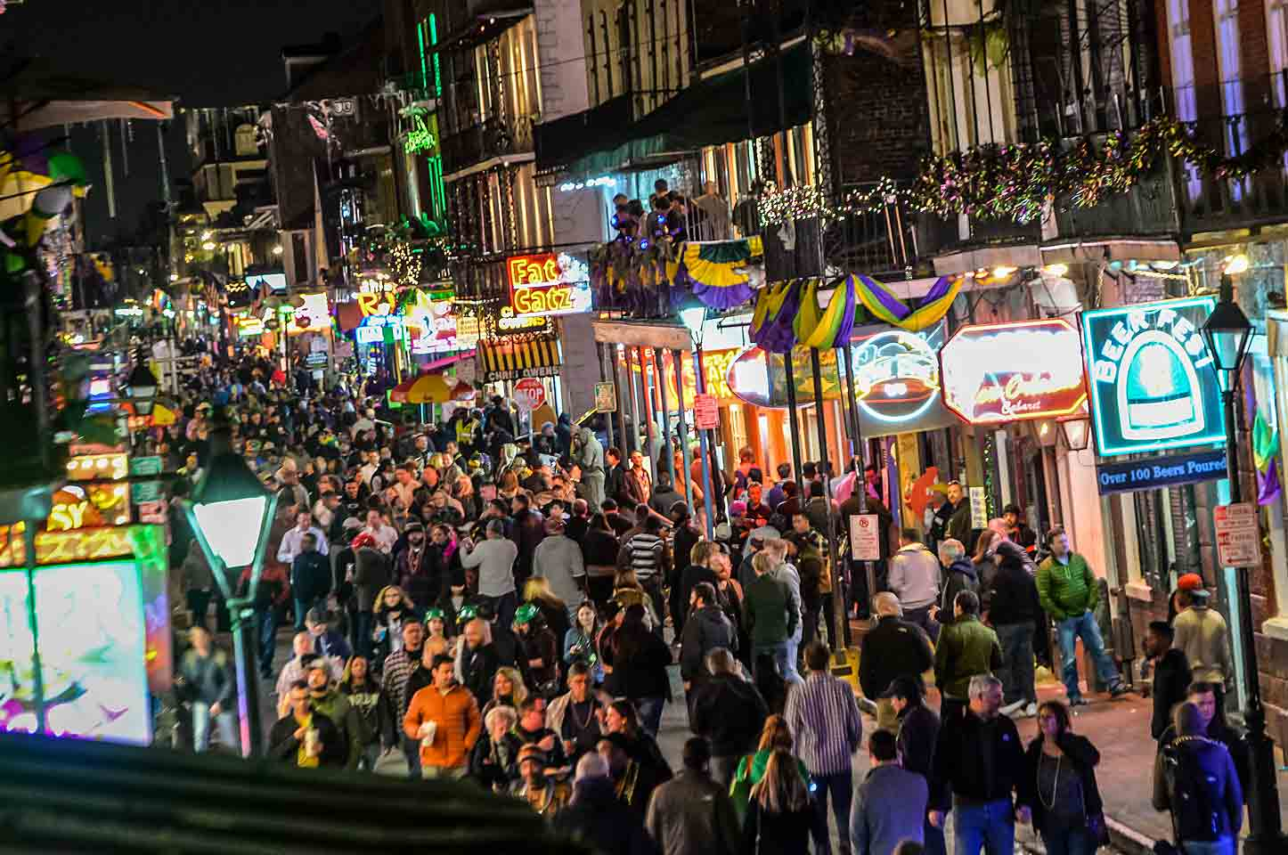Partying with two million of their closest friends on Bourbon Street.
