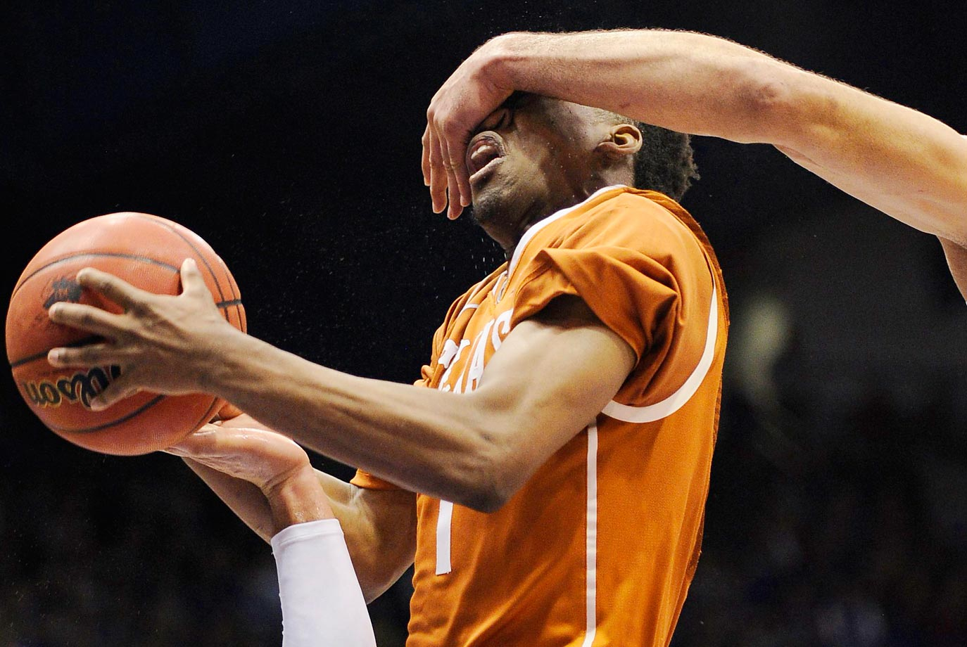 Isaiah Taylor of the Texas Longhorns is fouled during a game against the Kansas Jayhawks.