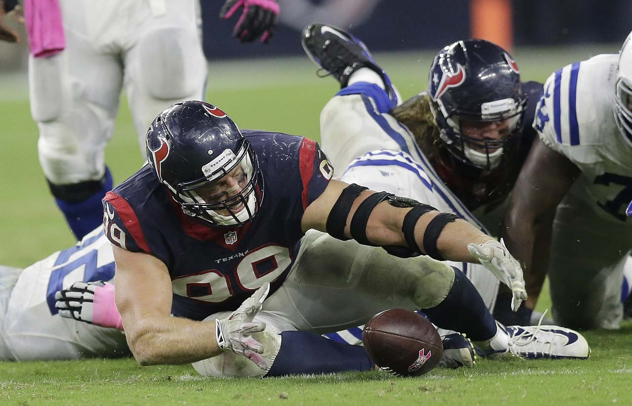 Houston Texans' J.J. Watt recovers a fumble that he eventually returned for a 45-yard touchdown against the Indianapolis Colts.
